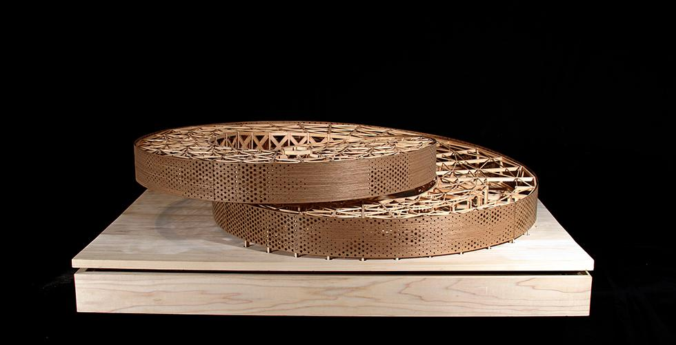 model of two circular pieces stacked askew