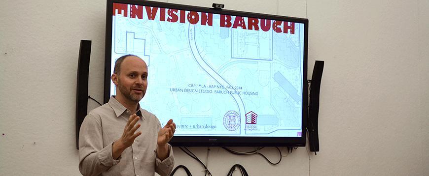 Adam Lubinsky speaking in front of smart board