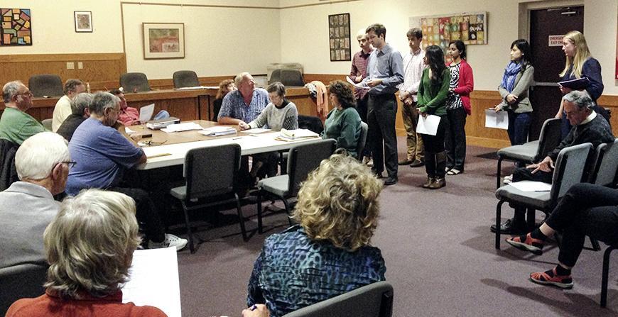 Team meeting with Lansing community members