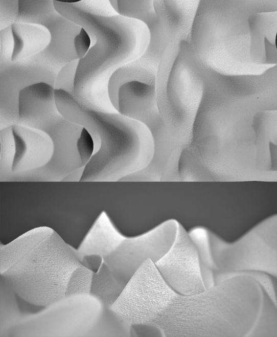 two black-and-white close-ups of the wavy surface of a model