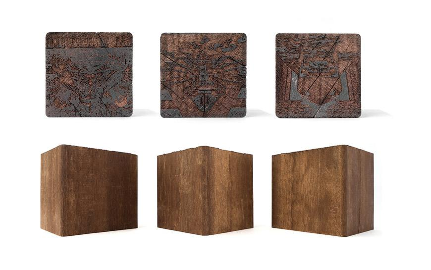 Etchings on three wood cubes.