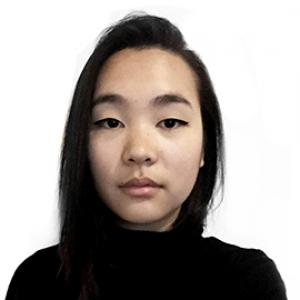 headshot of a young woman with dark hair wearing a black sweater
