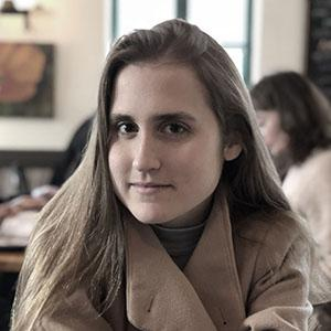 A woman with long brown hair.