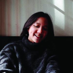 Woman with dark hair.