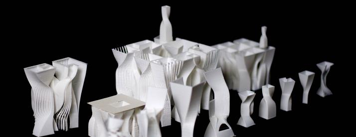 Study models of white, twisting structures.