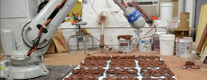 Robot arm creating clay weaves.