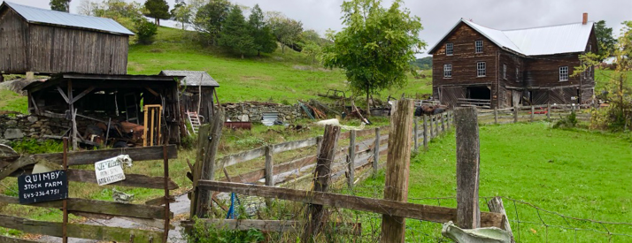 picture of farm building in hark wood and green hills