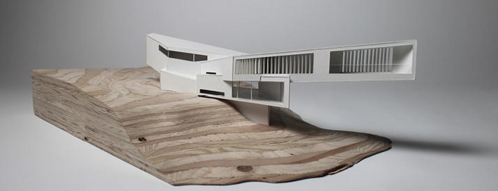 Model of structure on wooden platform.